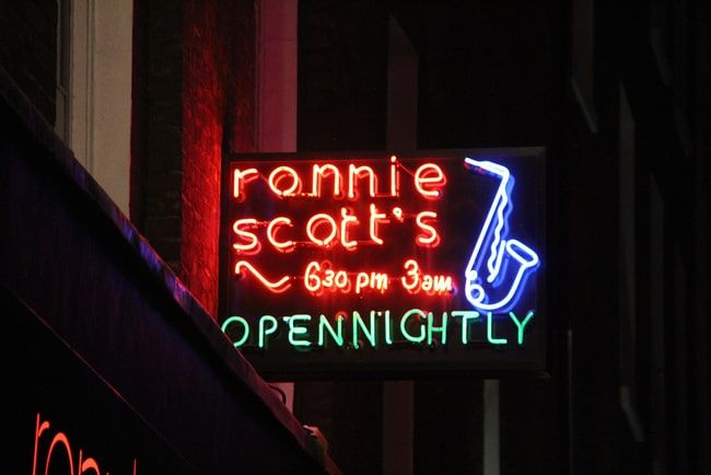 neon sign at night of Ronnie Scott's Open Nightly