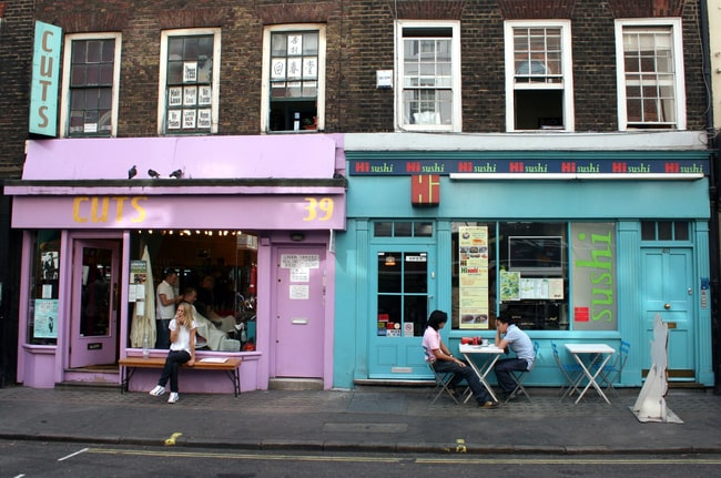 two street shop fronts in pastel blue and pink.