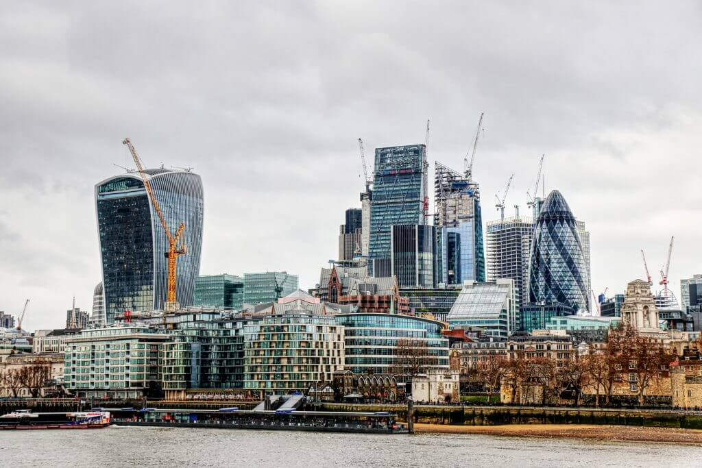 A landscape view of London featuring st. Marys Axe and 20 Fenchurch with a cloudy sky